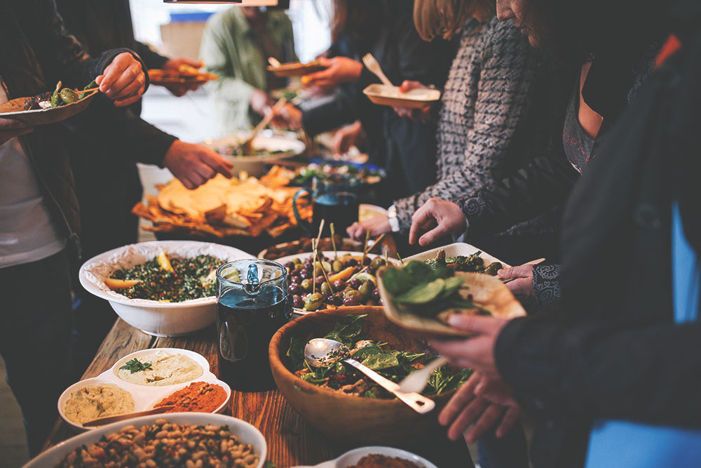 Here are a few ways to help you and your guests stay more in the present and enjoy eating without going overboard at your holiday party.